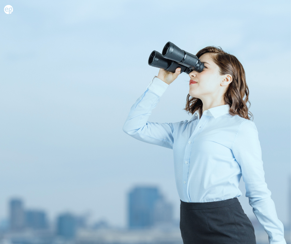 Woman searching with binoculars