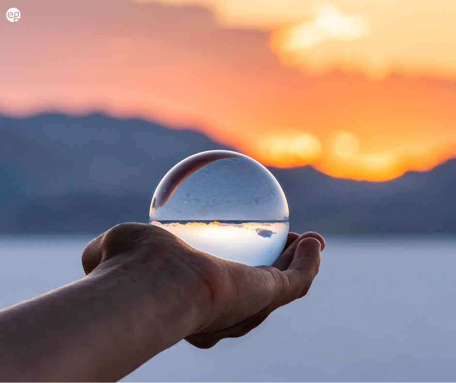 Transparent glass orb with a sunset in the background