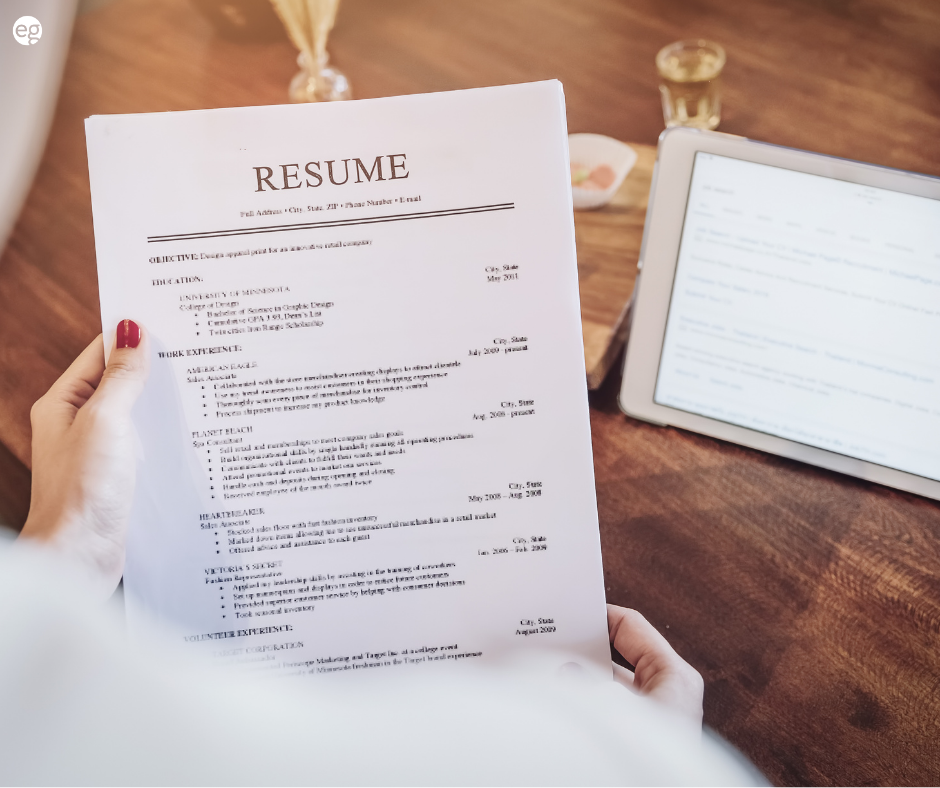 Woman's hands holding her resume