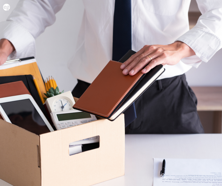 Man packing up his desk after resigning