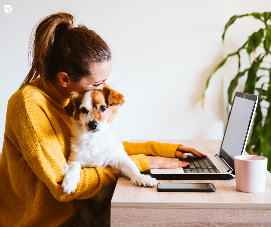 Woman working from home with dog