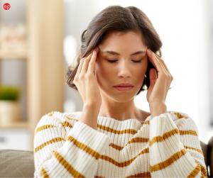 Woman rubbing her head in frustration