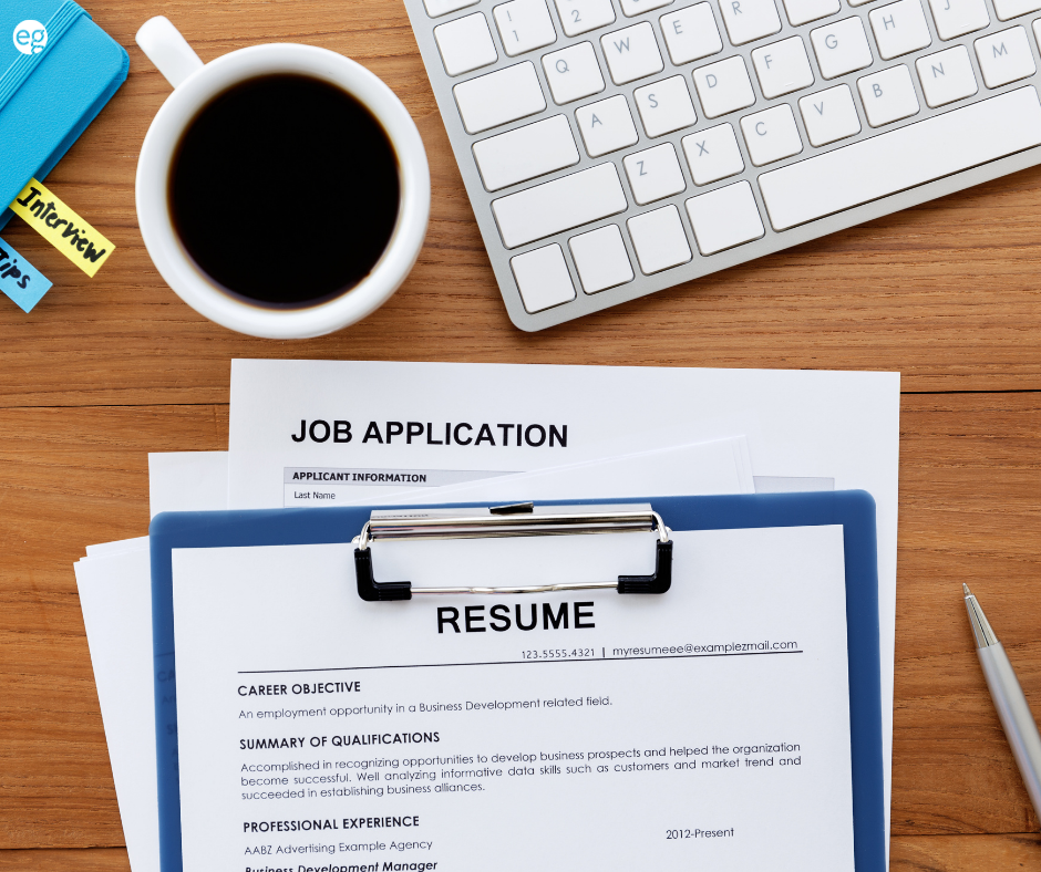 Resume and job searching supplies on a desk
