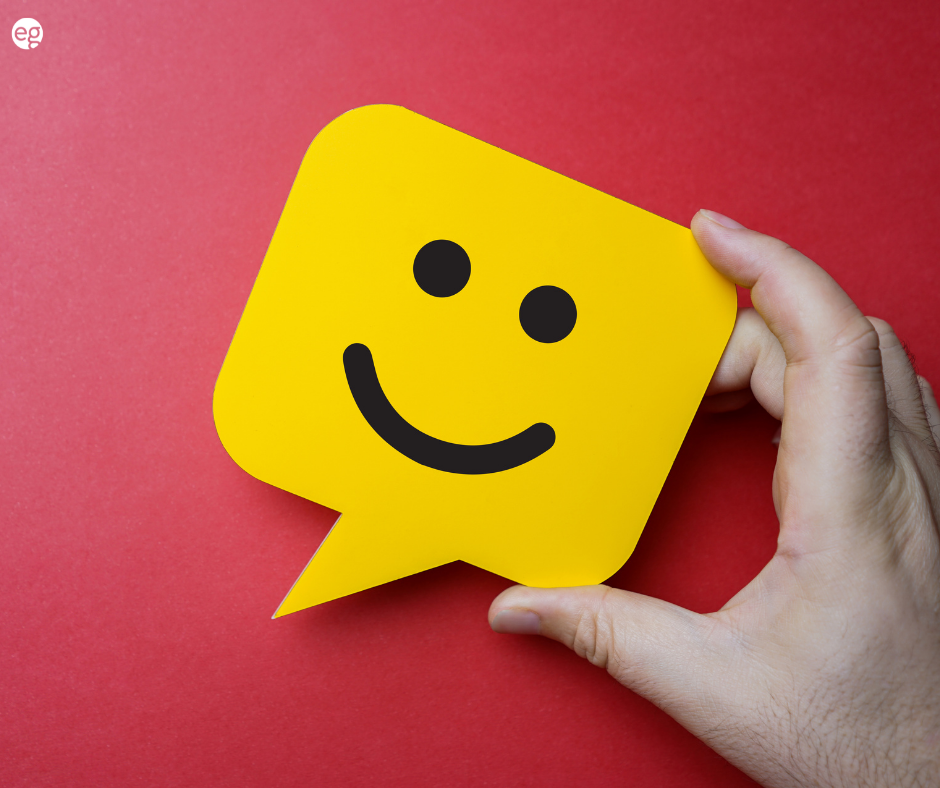 Smiling sticky note on a red background