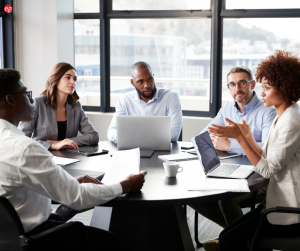 Diverse workers in a conference room