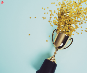 Trophy with star glitter and confetti spilling out