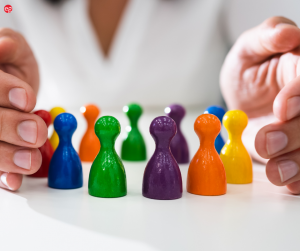 Woman's hands holding colorful plastic figures