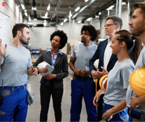 Factory Workers standing in a meeting