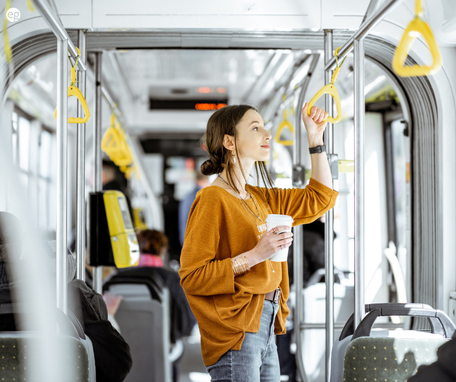 Young woman taking the bus to work