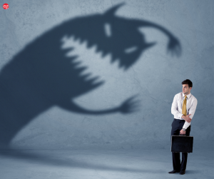 Shadow monster looming over man in business clothes