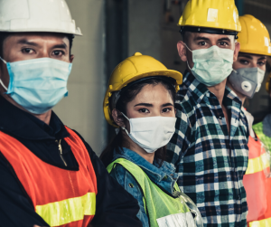 Workers in masks and PPE