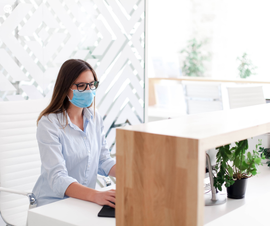 Masked women working in an office
