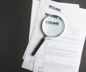 Resume with magnifying glass