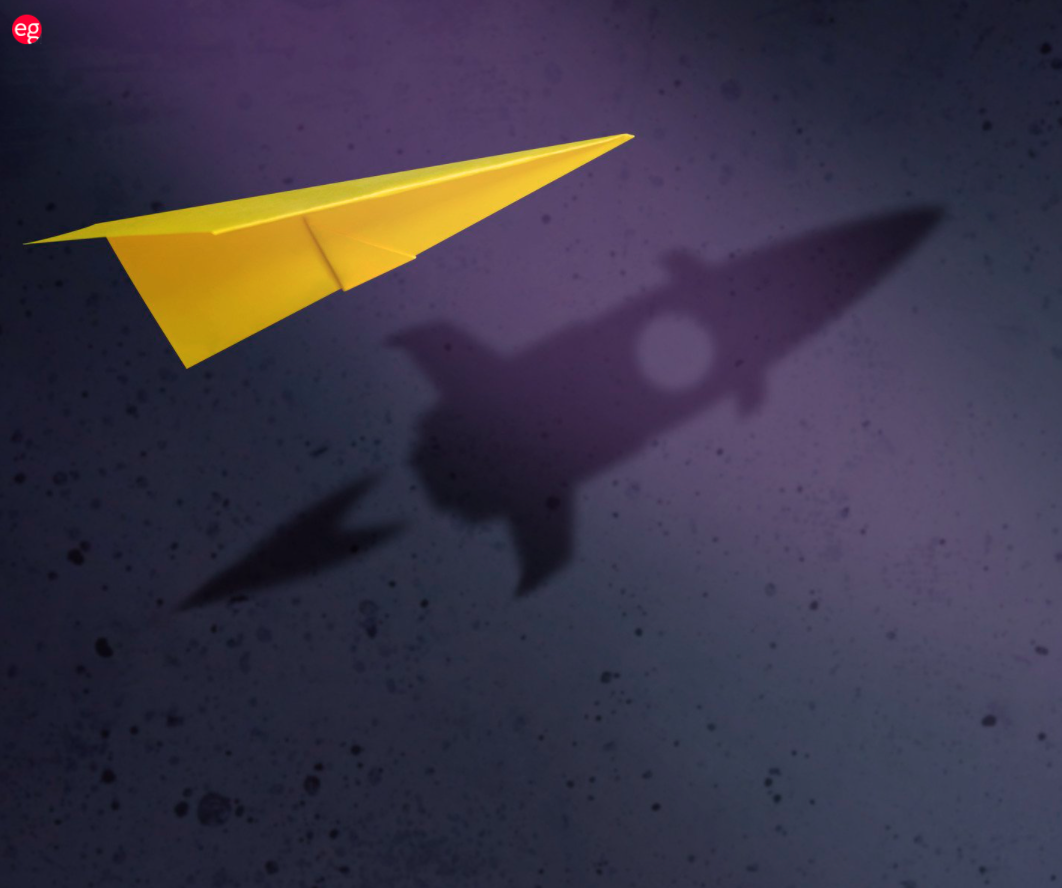 Yellow paper airplane with a rocket ship shadow