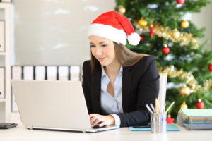 Business Woman in a Santa hat