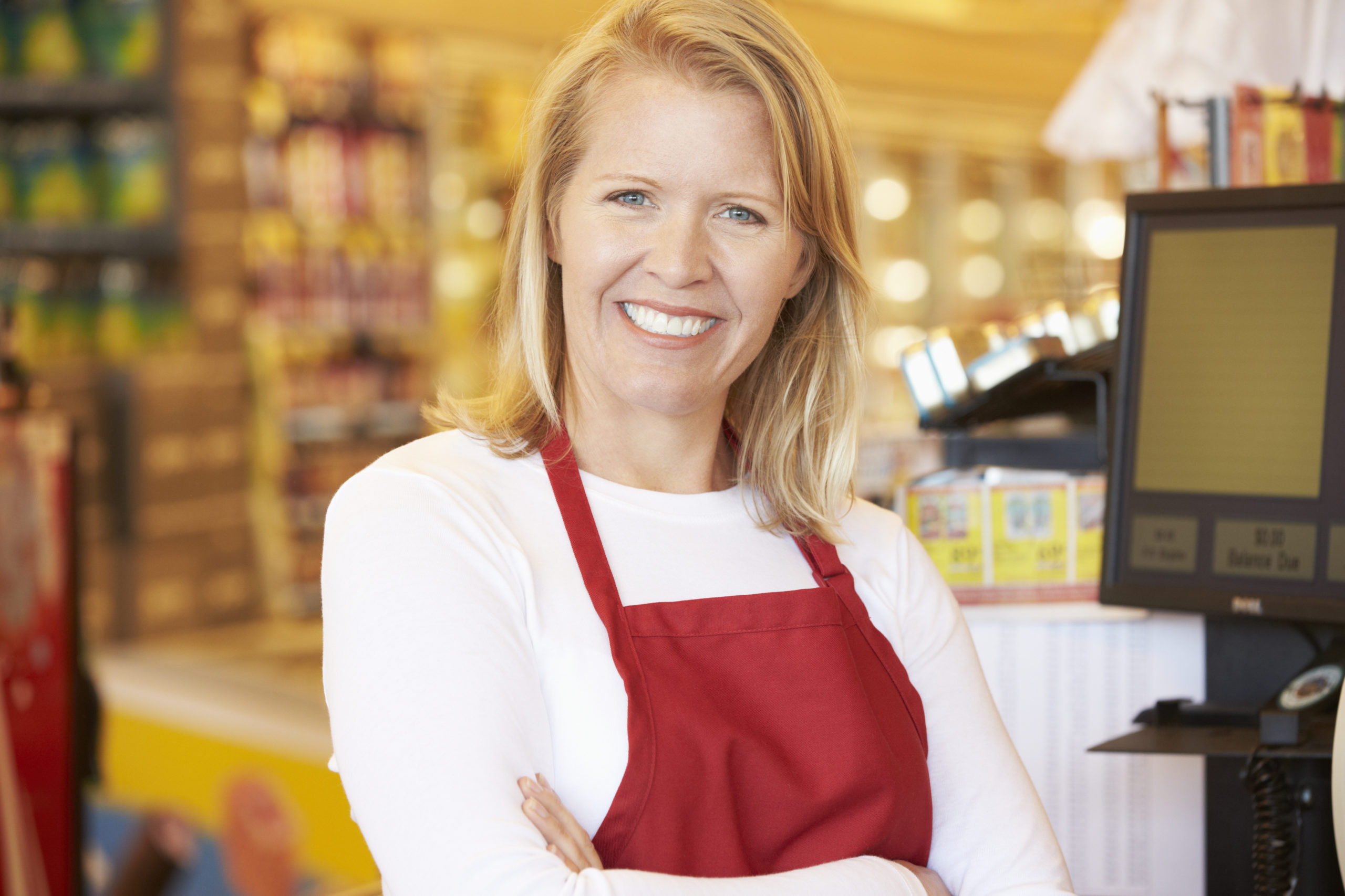 Retail worker in red apron